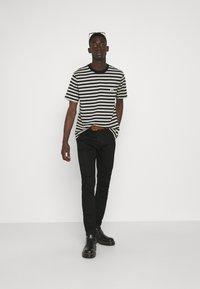 Levi's® Made & Crafted - LMC 512™ - Slim fit jeans - lmc laguna black - 1