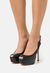 Guess - GINNIA - Platform heels - black - 0