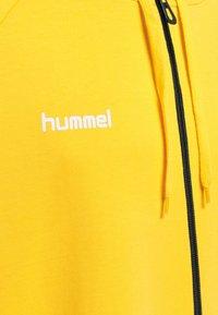 Hummel - HMLGO - Zip-up sweatshirt - yellow - 3
