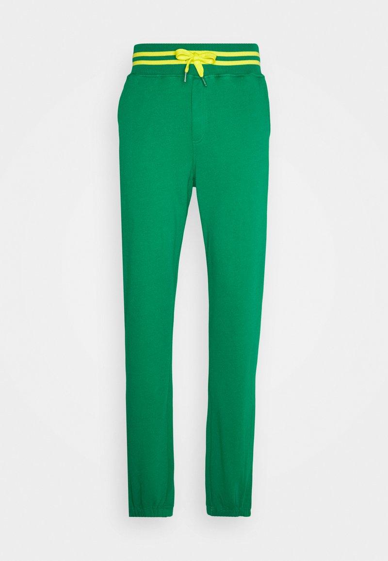 Schott - PHIL - Tracksuit bottoms - bresil green/yellow
