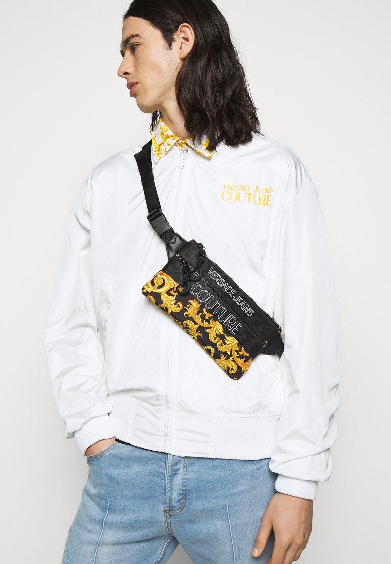 Versace Jeans Couture - UNISEX - Bum bag - black/gold