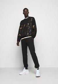 Versace Jeans Couture - Sweatshirt - black - 1
