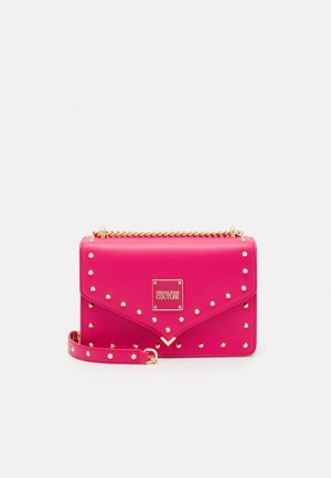 STUDS REVOLUTION CROSSBODY - Across body bag - fuxia