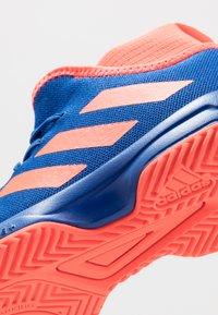 adidas Performance - Multicourt tennis shoes - collegiate royal/solar red - 5