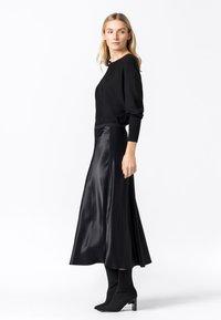 HALLHUBER - ROCK SWIRLING - A-line skirt - schwarz - 1