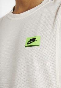 Nike Performance - DRY TANK  - Funktionströja - pale ivory/black - 5
