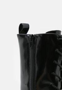 Monki - Platform ankle boots - black - 5