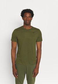 Nike Performance - TEE CREW SOLID - Basic T-shirt - rough green/black - 0