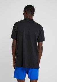 Nike Performance - HERITAGE - Funktionströja - black - 2