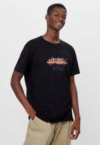 Bershka - T-shirt imprimé - black - 0