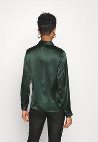 JDY - JDYFIFI LIFE SHORT SHIRT - Button-down blouse - scarab - 2