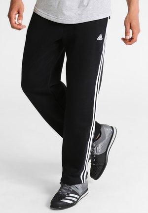 ESSENTIAL - Teplákové kalhoty - black/white