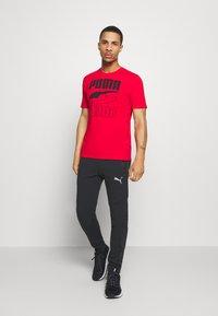 Puma - EVOSTRIPE - Pantalon de survêtement - black - 1