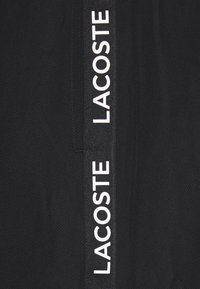 Lacoste Sport - TENNIS PANT TAPERED - Träningsbyxor - black/white - 6
