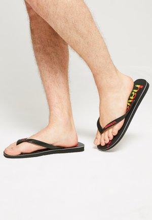 TOP LOGOMANIA  - Pool shoes - black/red