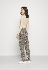 Pieces - PCDOLLY FLARED PANTS  - Trousers - carry over - 2