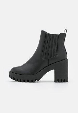 CHANDLER - Platform ankle boots - black paris