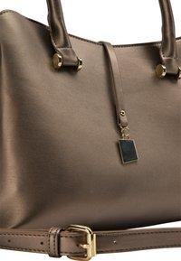 faina - Handbag - gold - 4