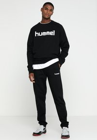 Hummel - HMLGO COTTON PANT - Tracksuit bottoms - black - 1
