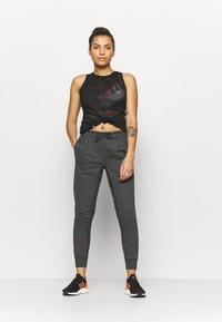 adidas Performance - Teplákové kalhoty - mottled dark grey - 1