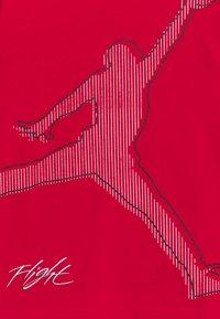 Jordan - JUMPMAN CITYTEE - T-shirt med print - gym red - 2