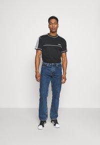adidas Originals - STITCH - T-shirts print - black - 1