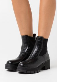 Buffalo - MARLOW - Platform ankle boots - black - 0