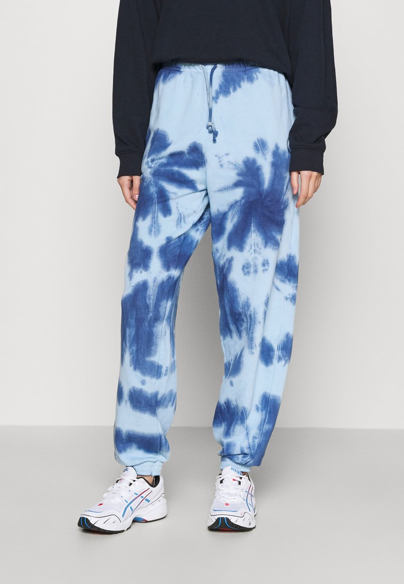 Topshop - SMUDGE TIE DYE JOGGER - Tracksuit bottoms - blue