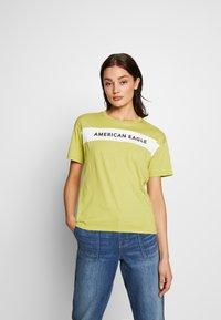 American Eagle - BRANDED SEAMED SANTA MONICA TEE - Print T-shirt - yellow - 0