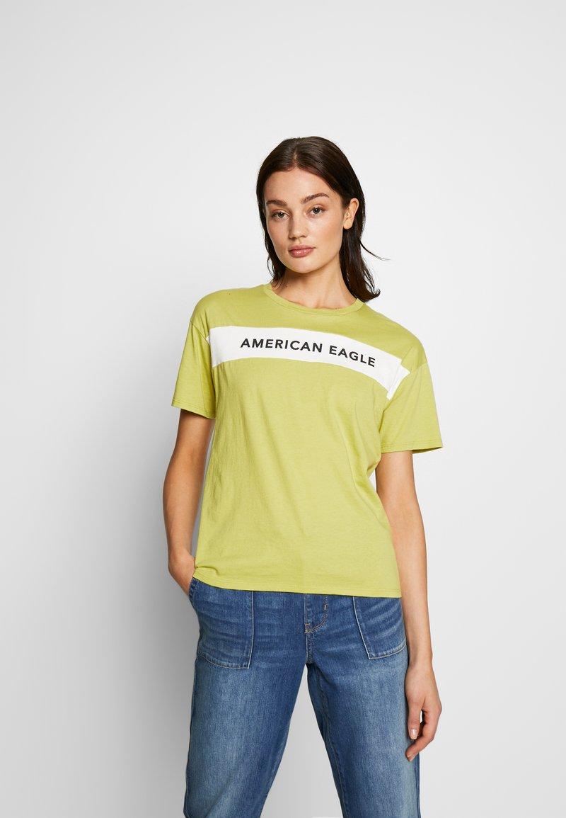 American Eagle - BRANDED SEAMED SANTA MONICA TEE - Print T-shirt - yellow