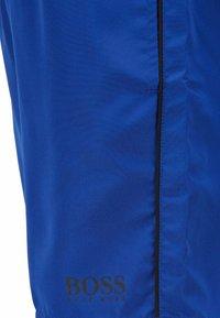 BOSS - STARFISH - Swimming shorts - open blue - 4
