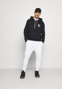 Nike Sportswear - HOODIE - Felpa con cappuccio - black - 1