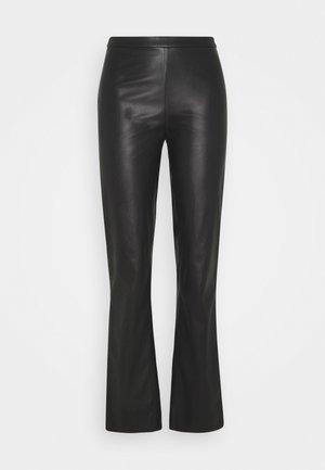 PRIANKA - Trousers - black