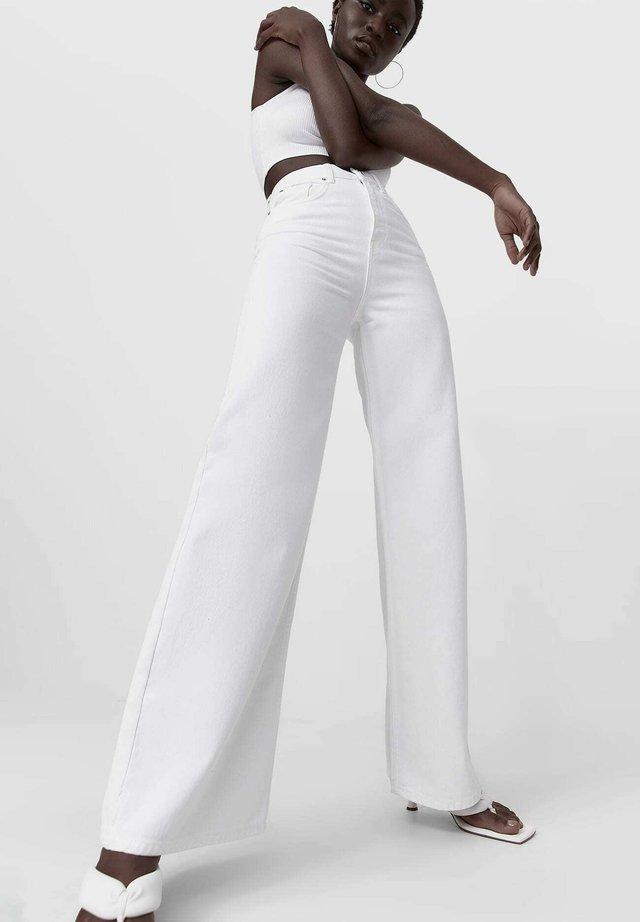 Široké džíny - white