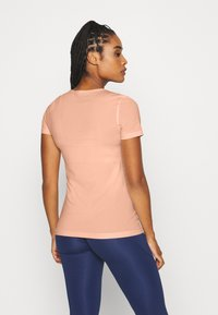 Nike Performance - ALL OVER - Basic T-shirt - washed coral - 2