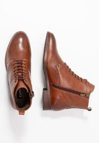 Caprice - Lace-up ankle boots - cognac - 3