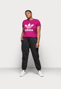 adidas Originals - CUFFED PANT - Tracksuit bottoms - black - 1