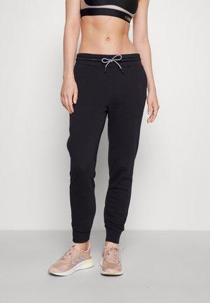 RIVAL PANT - Tracksuit bottoms - black/white