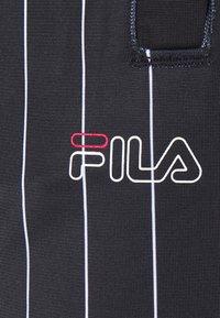 Fila - JAIMI PINSTRIPE TRACK PANTS - Teplákové kalhoty - black/bright white - 4