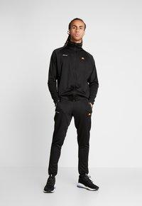 Ellesse - CALDWELO PANT - Teplákové kalhoty - black - 1