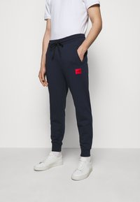 HUGO - DOAK - Teplákové kalhoty - dark blue - 0