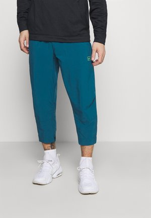 PANT - Tracksuit bottoms - green abyss/mean green