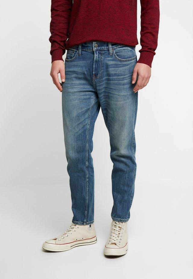 Zúžené džíny - medium