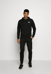 The North Face - GRAPHIC HOODIE - Luvtröja - tnf black/tnf white - 1