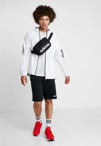 adidas Performance - ESSENTIALS LINEAR SPORT WAISTBAG - Bum bag - black/white - 2