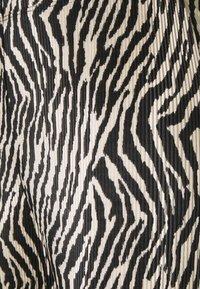 Topshop - ZEBRA PLISSE FLARE - Trousers - monochrome - 2