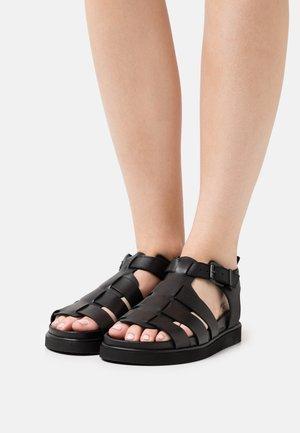 CORA - Sandaalit nilkkaremmillä - black