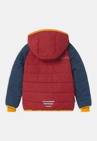 TrollKids - HAFJELL SNOW PRO UNISEX - Ski jacket - mystic blue/rusty red/golden yellow - 1