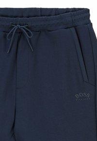 BOSS - HADIM - Tracksuit bottoms - dark blue - 5