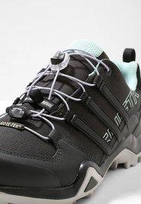 adidas Performance - TERREX SWIFT R2 GORE-TEX - Hiking shoes - core black/ash green - 5